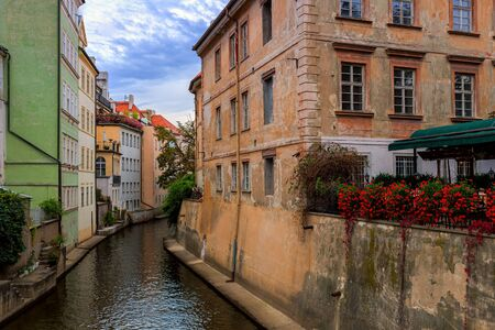 Narrow canal of Certovka river among houses in old town of Prague, Czech Republic.