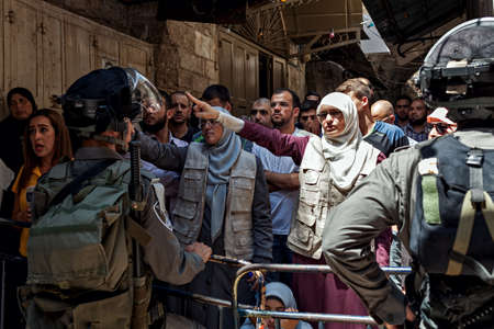 JERUSALEM, ISRAEL - JULY 26, 2015: Palestinians protest in Old City of Jerusalem against ascent of jews to Temple Mount during Tisha B'Av - annual fast day in Judaism commemorates destruction of First and Second Temples.