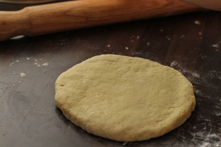 biscuit dough: Rolling our fresh biscuit dough on the table