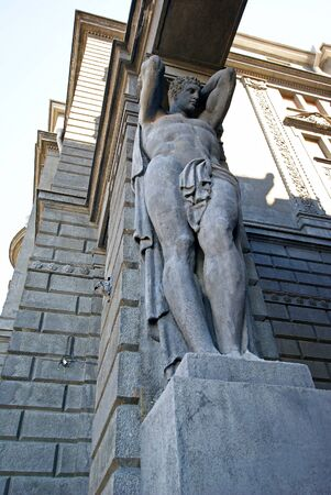 atlantes: Atlas at the main entrance to the building holding portal beam, sculptural support, telamon Stock Photo