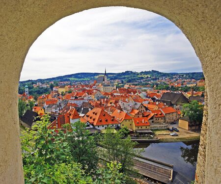 loophole: View of the city through a loophole castle of Cesky Krumlov Stock Photo