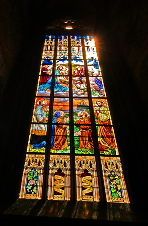 liturgical: Stained glass window in the church image of biblical scenes Editorial
