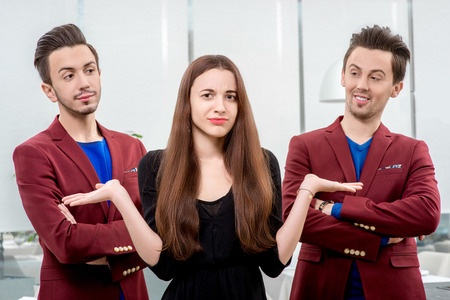 alike: Young and prety woman choosing boyfriend from two similar brothers