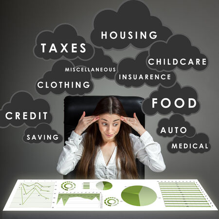 budget crisis: Young shocked woman calculating home budget with coceptual graphics on image Stock Photo