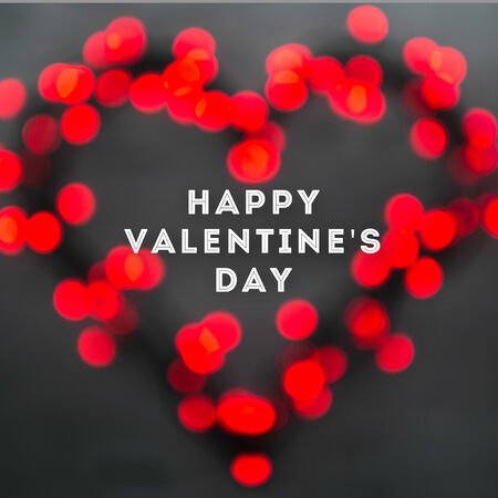 valentine background: Heart with red blurred lights on wooden dark background. Valentines day card concept Stock Photo