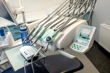 Dental chair with equipment in the dental office