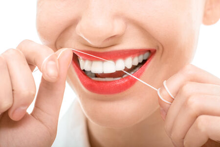 perfect teeth: Woman flossing teeth smiling, happy with perfect teeth and toothy smile on white background