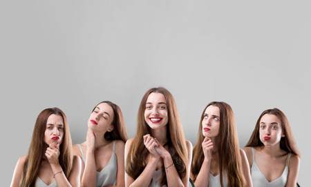 expressing: Collage of beautiful woman with different facial expressions on grey background Stock Photo