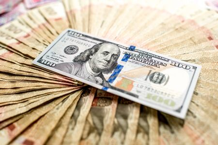 Pile of Ukrainian and American one hundred money banknots photo