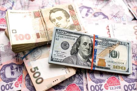 Pile of Ukrainian and American money banknots photo