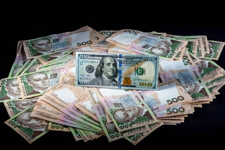 hryvna: Pile of Ukrainian and American money banknots Stock Photo