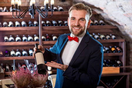 Sommelier with wine bottle in the wine cellar Stock Photo