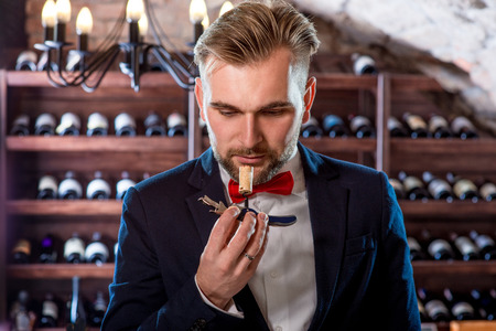 Sommelier smelling corck in the wine cellar