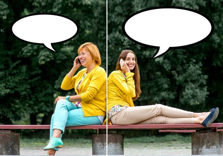 Mother talking with her daughter on the bench in the park photo
