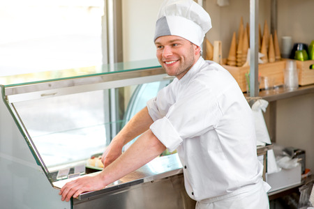 coif: Confectioner selling ice cream in the store Stock Photo