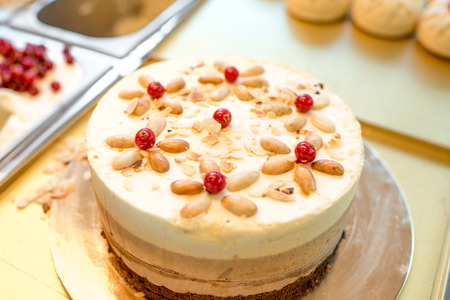 Sweet cake decorated with currant berries in the pastry shop