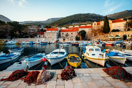 brac: Boats with fishing tools at marine in old city, Croatia