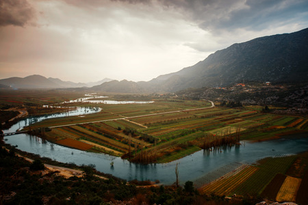 neretva: Croatian landscape view on Neretva river with mountains and fields
