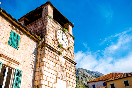 Clock tower in Kotor old city in Montenegro photo