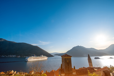 View on Kotor bay from Perast city with cruise liner and mountains on background photo