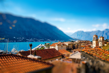 Top view with tiled red roofs and mountains in Kotor old city in Montenegro photo