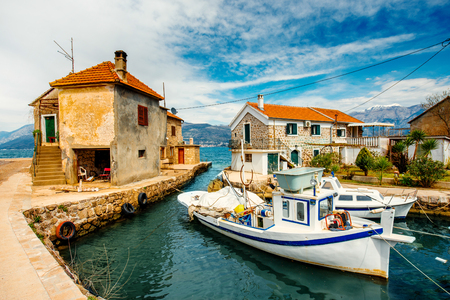 Old marina with two houses and boats in Montenegro photo