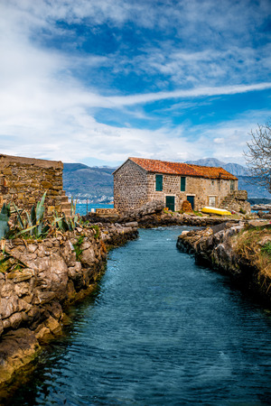 Old marina with lonely House and boat in Montenegro photo