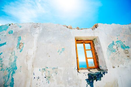 white view: Old window in abandoned house with beautiful view at sea