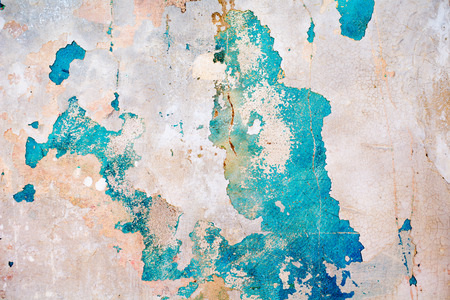 paint texture: An old ragged blue plaster wall texture