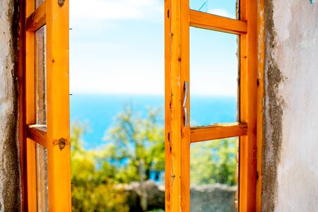 Old wooden window with view on seascape