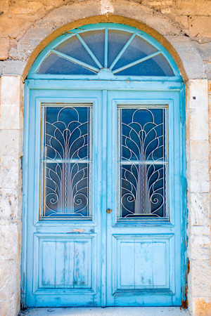 vintage door: Old blue painted vintage door in Greece Stock Photo