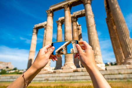 Photographing Zeus temple ruins with mobile phone photo