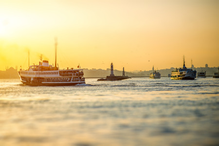 istanbul: Bosphorus strait with ferry boats on the sunset in Istanbul, Turkey Stock Photo