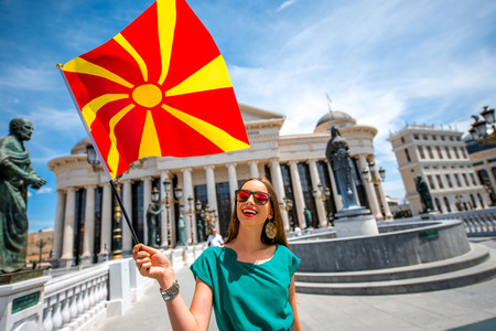 macedonian flag: Woman with macedonian flag in Skopje city center. Promoting tourism in Macedonia Editorial