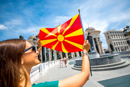 macedonian flag: Woman with macedonian flag in Skopje city center. Promoting tourism in Macedonia Stock Photo