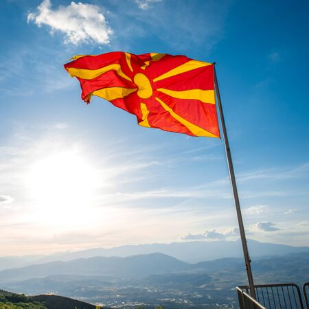 macedonian flag: Big macedonian flag vawing on the sky background on Vodno mountain.