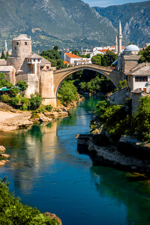 neretva: Beautiful view on Mostar city with old bridge and ancient buildings on Neretva river in Bosnia and Herzegovina