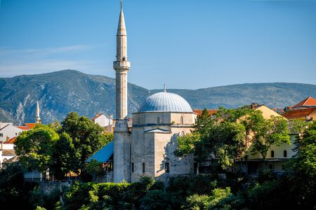 View on mosque from the old bridge in Mostar city
