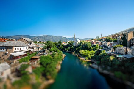 neretva: Beautiful view on Mostar city with Neretva river and ancient architecture from old bridge in Bosnia and Herzegovina