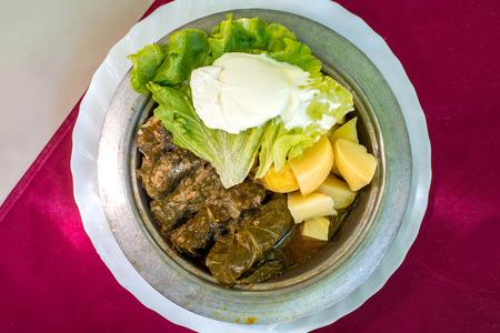 potatoe: Traditional Bosnian food jabrak with potatoe and salad on the metal plate