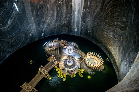 TURDA, ROMANIA - JUNE 30 2015: Underground lake in the Salt Mine Salina Turda museum in Romania