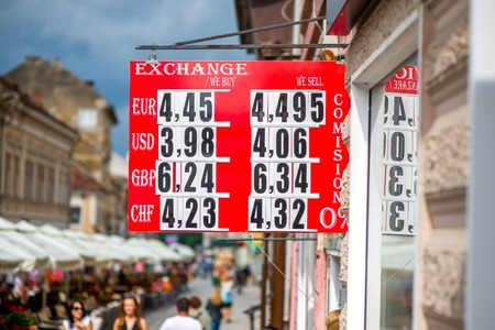 leu: Exchange table with romanian currency rates on the crowded street Stock Photo