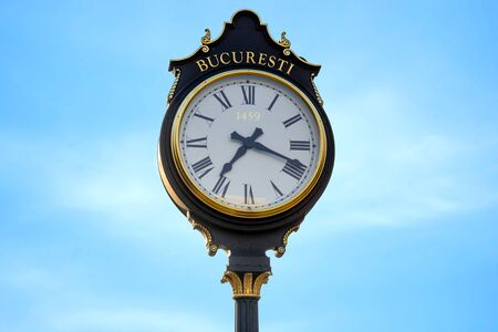 bucuresti: Parliament clocks in Bucharest city on the blue sky background