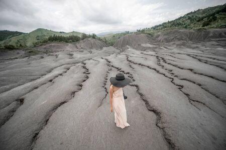 subduction: Female traveler near mud volcanoes in Buzau in Romania