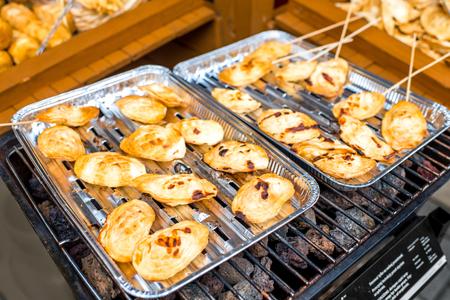 oscypek: Smoked cheese oscypek on the grill, polish street food