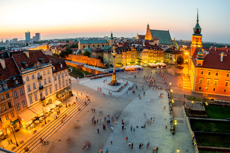 warszawa: Top view of Royal and old town crowded with people in Warsaw on the evening