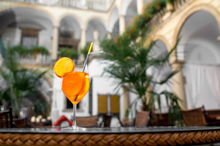 Aperol Spritz the traditional Italian aperitif cocktail on Italian yard background Stock Photo