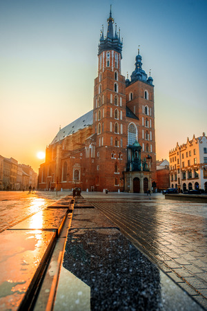Beautiful view on St. Marys Basilica at the market square in Krakow on the sunrise