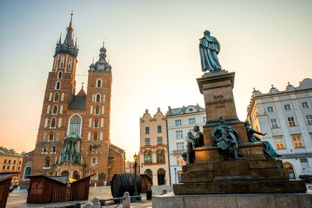 mickiewicz: Old city center view with Adam Mickiewicz monument and St. Marys Basilica in Krakow on the morning