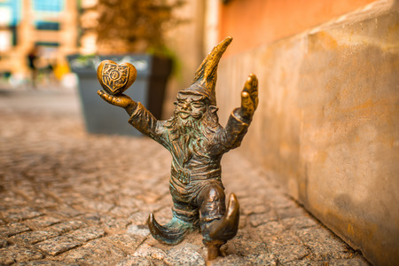 Small dwarf statue on the market square in Wroclaw